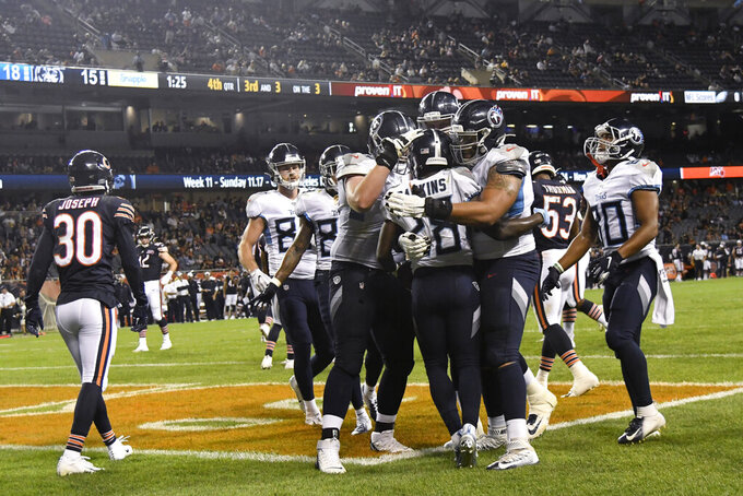 Tennessee Titans running back Dalyn Dawkins (28) celebrates with teammates after scoring a touchdown during the second half against the Chicago Bears in an NFL preseason football game Thursday, Aug. 29, 2019, in Chicago. Tennessee won 19-15. (AP Photo/David Banks)