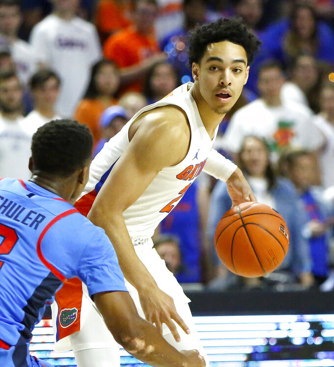 Florida guard Andrew Nembhard (2) looks to drive the ball into the paint as Mississippi's Devontae Shuler defends during an NCAA college basketball game Tuesday, Jan. 14, 2020, in Gainesville, Fla. (Brad McClenny/The Gainesville Sun via AP)