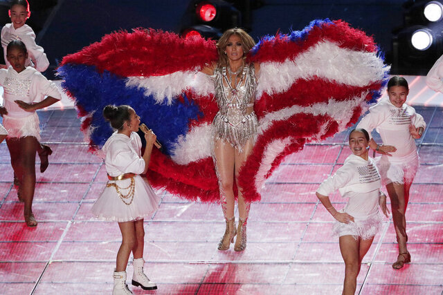 Jennifer Lopez and daughter Emme Maribel Muniz perform during halftime of the NFL Super Bowl 54 football game Sunday, Feb. 2, 2020, in Miami Gardens, Fla. (AP Photo/Charlie Riedel)