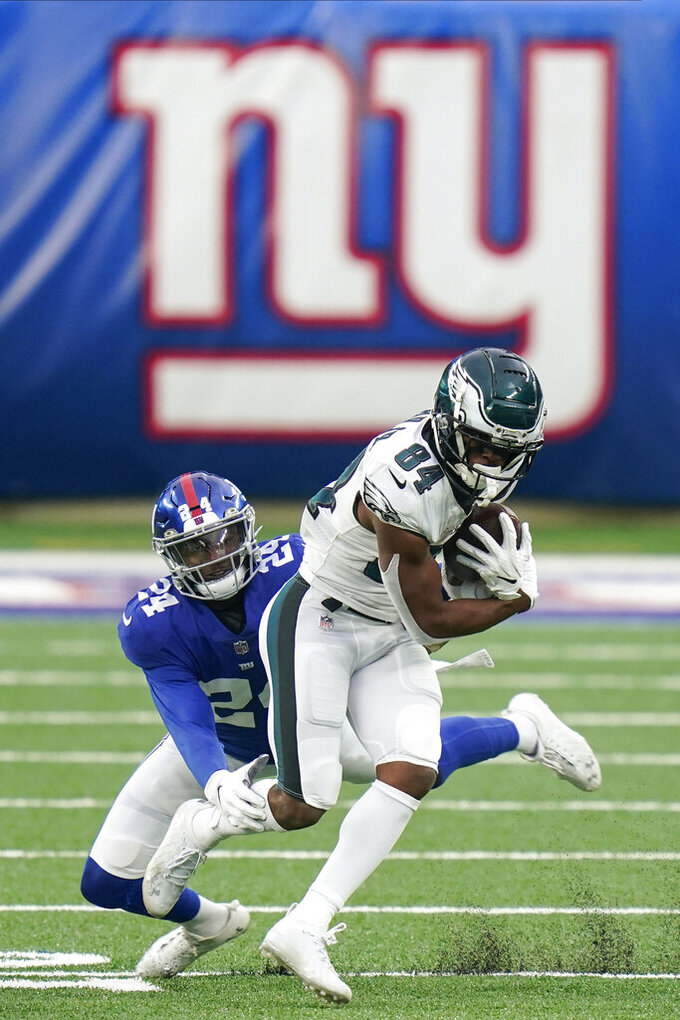 New York Giants' James Bradberry (24) tackles Philadelphia Eagles' Greg Ward (84) during the second half of an NFL football game Sunday, Nov. 15, 2020, in East Rutherford, N.J. (AP Photo/Seth Wenig)