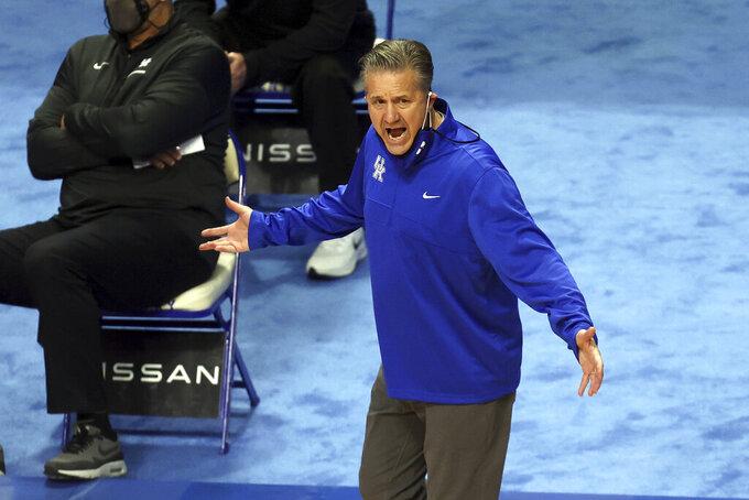 Kentucky head coach John Calipari reacts to a call during the first half of an NCAA college basketball game against Arkansas in Lexington, Ky., Tuesday, Feb. 9, 2021. (AP Photo/James Crisp)