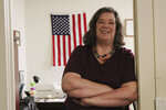ADVANCE FOR RELEASE SUNDAY, SEPT. 8, 2019, AND THEREAFTER - In this Aug. 9, 2019, photo, Joan Lamunyon Sanford, executive director of the New Mexico Religious Coalition for Reproductive Choice, poses for a photograph in her office in Albuquerque, N.M. The group helps an average of 100 women a year but is on track to assist 200 this year. Lamunyon Sanford said the need is growing as barriers increase and women are unable to access care where they live. (AP Photo/Susan Montoya Bryan)