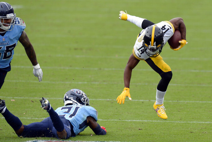 Pittsburgh Steelers wide receiver Ray-Ray McCloud (14) flies through he air after being hit by Tennessee Titans cornerback Malcolm Butler (21) in the second half of an NFL football game Sunday, Oct. 25, 2020, in Nashville, Tenn. (AP Photo/Mark Zaleski)