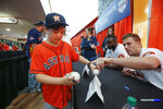 Houston Astros' Myles Straw, right, points to the baseball he signed for Noah Jackson, 9, during FanFest at Minute Maid Park on Saturday, Jan. 18, 2020, in Houston. (Steve Gonzales/Houston Chronicle via AP)