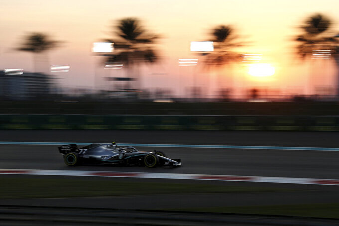Mercedes driver Valtteri Bottas of Finland steers his car during the first free practice at the Yas Marina racetrack in Abu Dhabi, United Arab Emirates, Friday, Nov. 29, 2019. The Emirates Formula One Grand Prix will take place on Sunday. (AP Photo/Kamran Jebreili)