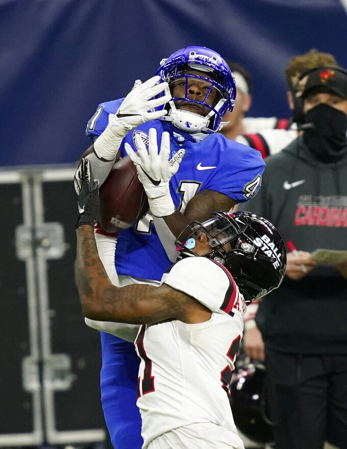 Ball State cornerback Antonio Phillips, foreground, intercepts a pass intended for Buffalo wide receiver Antonio Nunn (41) during the second half of the Mid-American Conference championship NCAA college football game, Friday, Dec. 18, 2020, in Detroit. (AP Photo/Carlos Osorio)