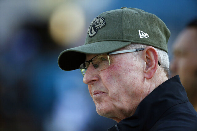 File-This photo taken Aug. 29, 2019, shows Tom Coughlin, executive vice president of football operations for the Jacksonville Jaguars watching players warm up before an NFL preseason football game in Jacksonville, Fla. Owner Shad Khan has a decision to make about the Jaguars (4-7), who are on the verge of missing the playoffs for the 11th time in the last 12 years. Khan hired Coughlin and head coach Doug Marrone at the same time in 2017, adding them to incumbent general manager Dave Caldwell and creating a triumvirate that worked well for two seasons. It now appears to be falling apart. Marrone took a shot at Coughlin on Tuesday, the first clear sign of internal strife. (AP Photo/Stephen B. Morton, File)