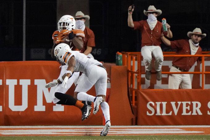 Texas's Brennan Eagles, back, catches a touchdown pass against UTEP during the second half of an NCAA college football game in Austin, Texas, Saturday, Sept. 12, 2020. (AP Photo/Chuck Burton)