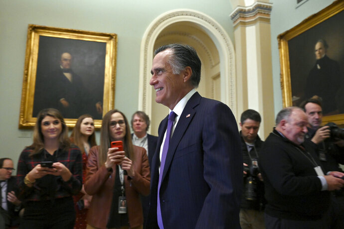 Sen. Mitt Romney, R-Utah, walks on Capitol Hill in Washington, Tuesday, Feb. 25, 2020. (AP Photo/Susan Walsh)