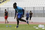 In this Saturday, May 4, 2019, Francis Kalombo from Congo, center, practices with his teammates of Aiolikos during a training session at the Municipality stadium of Mytilene, on the northeastern Aegean island of Lesbos, Greece. A 10-minute walk from Europe's largest refugee camp sits a nondescript yet remarkable soccer field. It's a place where residents of the Moria camp on the Greek island of Lesbos can briefly forget about their tiny container-homes and crowded tents and instead worry about corner kicks and throw-ins. And it's the place where 15-year-old Francis Kalombo became the first refugee to sign for a professional Greek soccer club. (AP Photo/Thanassis Stavrakis)
