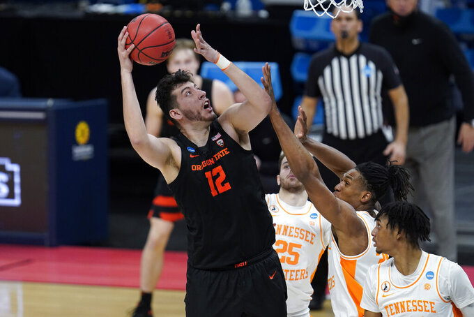 Oregon State center Roman Silva (12) shoots against Tennessee during the second half of a men's college basketball game in the first round of the NCAA tournament at Bankers Life Fieldhouse in Indianapolis, Friday, March 19, 2021. (AP Photo/Paul Sancya)