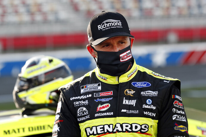 FILE - In this May 28, 2020, file photo, Matt DiBenedetto waits for the start of a NASCAR Cup Series auto race at Charlotte Motor Speedway  in Concord, N.C. DiBenedetto, Ryan Blaney, William Byron and Cole Custer are the four drivers below the cutline headed into the knockout race. (AP Photo/Gerry Broome, File)