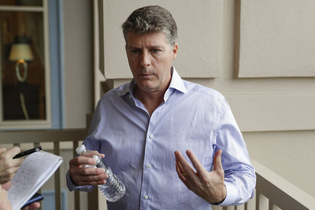 FILE - In this Wednesday, Feb. 5, 2020, file photo, Hal Steinbrenner, principal owner of the New York Yankees, talks with reporters during MLB baseball owners meetings, in Orlando, Fla. Steinbrenner apologized to Yankees fans, Tuesday, Oct. 13, 2020, for the team's postseason failure, much like his father did 39 years earlier. (AP Photo/John Raoux, File)