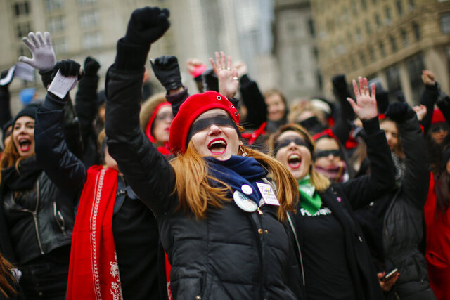Women take part in a rally before the Women's Women's March  on Saturday, Jan. 18, 2020 in New York.  Hundred showed up in New York City and thousands in Washington, D.C. for the rallies, which aim to harness the political power of women, although crowds were noticeably smaller than in previous years. Marches were scheduled Saturday in more than 180 cities. (AP Photo/Eduardo Munoz Alvarez)