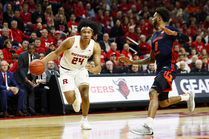 Rutgers guard Ron Harper Jr. (24) drives to the basket past Illinois guard Alan Griffin (0) during the second half of an NCAA college basketball game Saturday, Feb. 15, 2020, in Piscataway, N.J. (AP Photo/Adam Hunger)