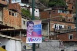 A presidential election campaign sign of Venezuelan President Nicolas Maduro hangs in the neighborhood of San Agustin in Caracas, Venezuela, Wednesday, May 16, 2018. While polls show most Venezuelans believe President Nicolas Maduro will coast to a second term in the May 20 election, he'll have a tough job convincing many Venezuelans and foreign governments that the vote was fair. Officials blocked his main opponents from running.  (AP Photo/Ariana Cubillos)
