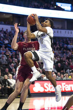 Wake Forest's Brandon Childress (0) shoots over Florida State's Dominik Olejniczak (15) in the first half of an NCAA college basketball game Wednesday, Jan. 8, 2020 in Winston-Salem, N.C. (AP Photo/Lynn Hey)