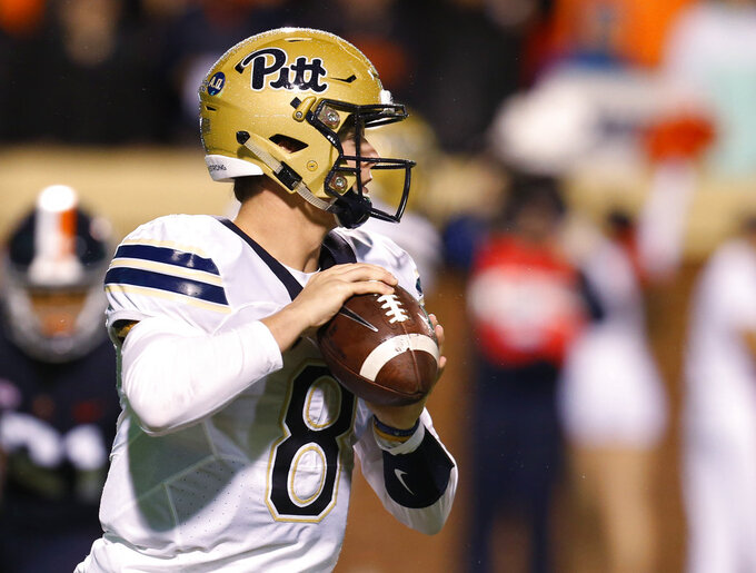 Pittsburgh quarterback Kenny Pickett looks downfield to pass during the first half of the team's NCAA college football game against Virginia in Charlottesville, Va., Friday, Nov. 2, 2018. (AP Photo/Steve Helber)