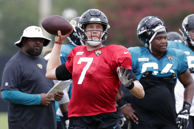 Jacksonville Jaguars quarterback Nick Foles (7) throws a pass during an NFL football practice at the teams training facility, Thursday, Aug. 1, 2019, in Jacksonville, Fla. (AP Photo/John Raoux)