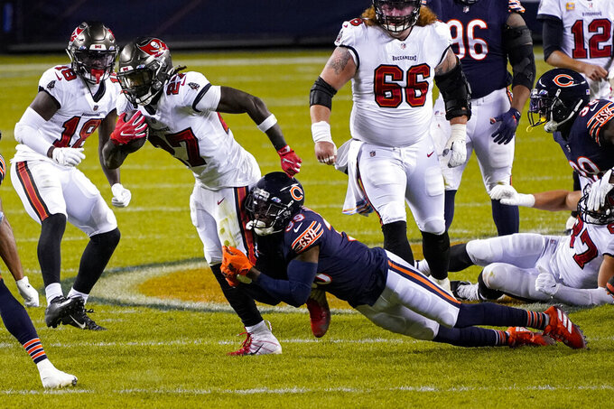 Tampa Bay Buccaneers running back Ronald Jones (27) is tackled by Chicago Bears free safety Eddie Jackson (39) during the first half of an NFL football game in Chicago, Thursday, Oct. 8, 2020. (AP Photo/Charles Rex Arbogast)