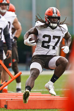 Cleveland Browns running back Kareem Hunt runs a drill during practice at the NFL football team's training camp facility, Tuesday, Aug. 17, 2021, in Berea, Ohio. (AP Photo/Tony Dejak)