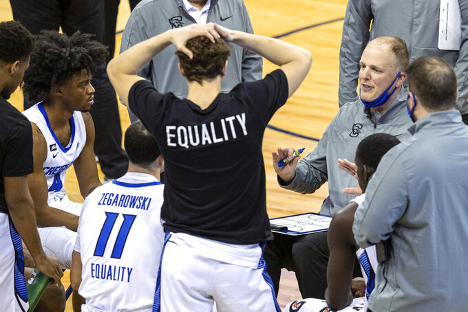Creighton assistant coach Alan Huss talks to players during the second half against Butler in an NCAA college basketball game Saturday, March 6, 2021, in Omaha, Neb. Creighton coach Greg McDermott was suspended earlier in the week. (Chris Machian/Omaha World-Herald via AP)