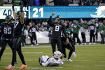 New York Jets kicker Sam Ficken (9) reacts as he watches his 44-yard field goal split the uprights against the Miami Dolphins to end an NFL football game, Sunday, Dec. 8, 2019, in East Rutherford, N.J. The Jets won 22-21.(AP Photo/Seth Wenig)