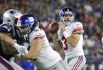 New York Giants quarterback Alex Tanney (3) looks for a receiver in the first half of an NFL preseason football game against the New England Patriots, Thursday, Aug. 29, 2019, in Foxborough, Mass. (AP Photo/Elise Amendola)