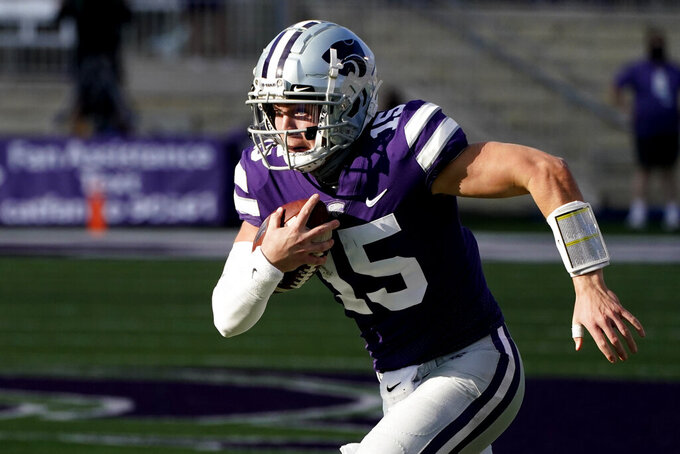 Kansas State quarterback Will Howard (15) runs the ball during the second half of an NCAA college football game against Texas Tech, Saturday, Oct. 3, 2020, in Manhattan, Kan. (AP Photo/Charlie Riedel)