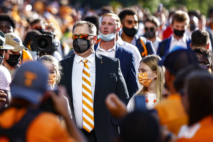 Tennessee coach Josh Heupel walks past fans during the Vol Walk before the team's NCAA college football game against Bowling Green on Thursday, Sept. 2, 2021, in Knoxville, Tenn. (AP Photo/Wade Payne)