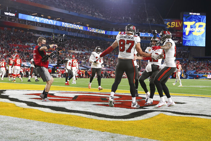 Tampa Bay Buccaneers tight end Rob Gronkowski (87) celebrates after a catch for a touchdown during the NFL Super Bowl 55 football game against the Kansas City Chiefs, Sunday, Feb. 7, 2021, in Tampa, Fla. (Ben Liebenberg via AP)