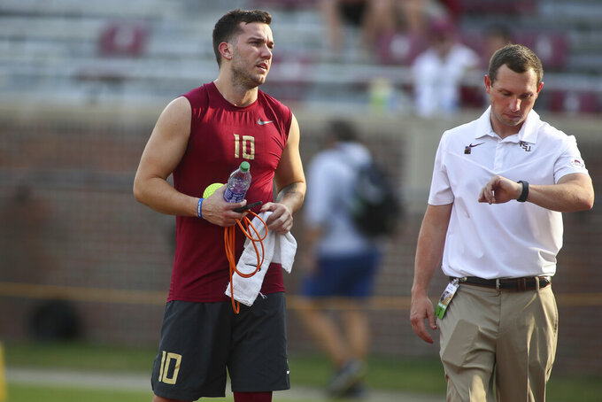 Florida State quarterback McKenzie Milton (10) and offensive coordinator/quarterbacks coach Kenny Dillingham before the start of an NCAA college football game against Jacksonville State Saturday, Sept. 11, 2021, in Tallahassee, Fla. (AP Photo/Phil Sears)