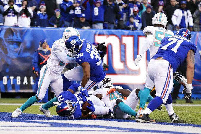 New York Giants running back Javorius Allen (37) scores a touchdown in the second half of an NFL football game against the Miami Dolphins, Sunday, Dec. 15, 2019, in East Rutherford, N.J. (AP Photo/Adam Hunger)