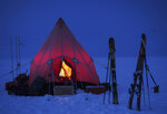 In this handout photo provided by British Antarctic Survey, a pyramid tent is seen in Trident area, Adelaide island, Antarctica in March 2020. Antarctica remains the only continent without COVID-19 and now in Sept. 2020, as nearly 1,000 scientists and others who wintered over on the ice are seeing the sun for the first time in months, a global effort wants to make sure incoming colleagues don't bring the virus with them. (Robert Taylor/British Antarctic Survey via AP)
