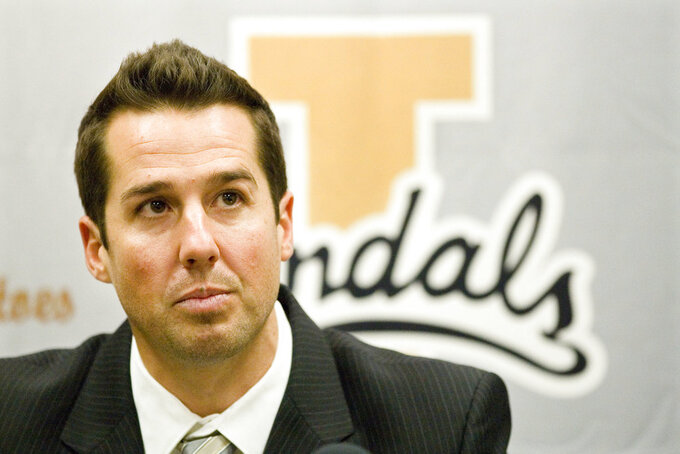 FILE - In this Oct. 22, 2012, file photo, Idaho interim head football coach Jason Gesser speaks during a news conference in Moscow, Idaho. Washington State University officials investigated allegations of sexual harassment against staff member and former football star Gesser and found no violations of school policy, it was announced Thursday, Sept. 13, 2018. (Geoff Crimmins/The Moscow-Pullman Daily News via AP, File)