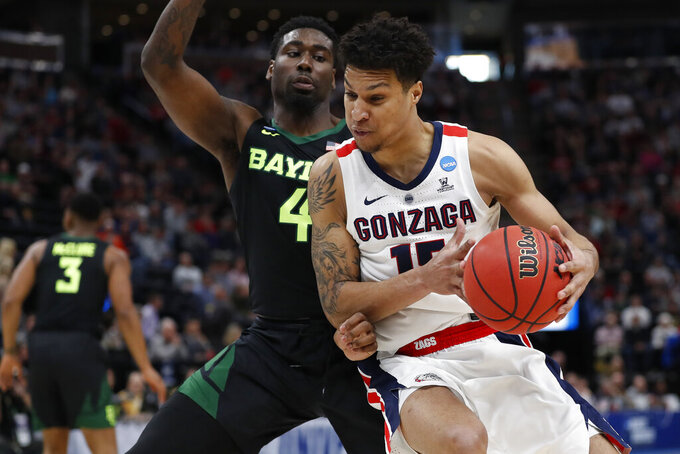 Gonzaga forward Brandon Clarke, right, looks to turn on Baylor guard Mario Kegler (4) during the first half of a second-round game in the NCAA men's college basketball tournament Saturday, March 23, 2019, in Salt Lake City. (AP Photo/Jeff Swinger)