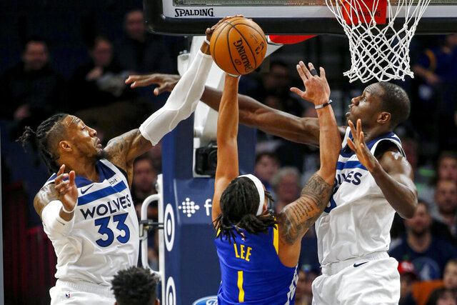 Minnesota Timberwolves forward Robert Covington (33) and center Gorgui Dieng (5) defend against Golden State Warriors guard Damion Lee (1) in the first half of an NBA basketball game Thursday, Jan. 2, 2020, in Minneapolis. (AP Photo/Bruce Kluckhohn)