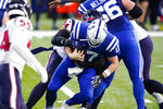 Houston Texans defensive end Charles Omenihu (94) sacks Indianapolis Colts quarterback Philip Rivers (17) in the first half of an NFL football game in Indianapolis, Sunday, Dec. 20, 2020. (AP Photo/Darron Cummings)