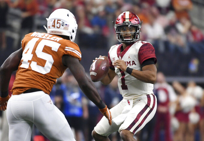 Oklahoma quarterback Kyler Murray (1) looks to pass as Texas linebacker Anthony Wheeler (45) applies pressure during the first half of the Big 12 Conference championship NCAA college football game on Saturday, Dec. 1, 2018, in Arlington, Texas. (AP Photo/Jeffrey McWhorter)