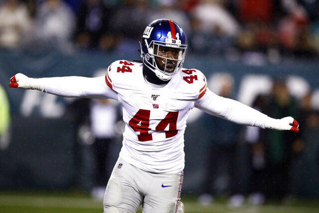 FILE - In this Dec. 9, 2019, file photo, New York Giants linebacker Markus Golden reacts during an NFL football game against the Philadelphia Eagles in Philadelphia. The Giants improved their pass rush by re-signing Golden, the team announced Tuesday, Aug.4, 2020. (AP Photo/Matt Rourke, File)