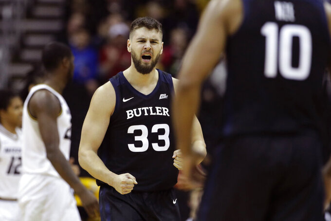 Butler forward Bryce Golden (33) celebrates after making a basket during the first half of an NCAA college basketball game against Missouri, Monday, Nov. 25, 2019, in Kansas City, Mo. (AP Photo/Charlie Riedel)
