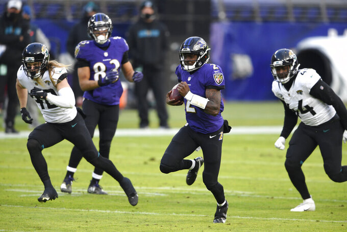 Baltimore Ravens quarterback Tyler Huntley (2) runs with the ball against the Jacksonville Jaguars during the second half of an NFL football game, Sunday, Dec. 20, 2020, in Baltimore. The Ravens won 40-14. (AP Photo/Nick Wass)