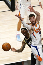 Atlanta Hawks guard Lou Williams (6) loses control of the ball as he drives against Phoenix Suns forward Frank Kaminsky (8) in the second half of an NBA basketball game Wednesday, May 5, 2021, in Atlanta. (AP Photo/John Bazemore)