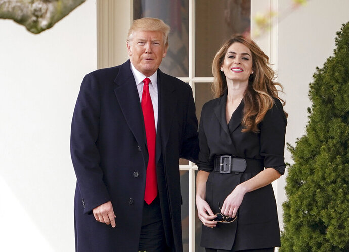 FILE - In this March 29, 2018 file photo, President Donald Trump poses for members of the media with then White House Communications Director Hope Hicks on her last day before he boards Marine One on the South Lawn of the White House in Washington. Hicks, one of President Donald Trump's most trusted and longest-serving aides, is returning to the White House. Hicks will be serving as counselor to the president, working with presidential son-in-law and senior adviser Jared Kushner.  (AP Photo/Andrew Harnik)