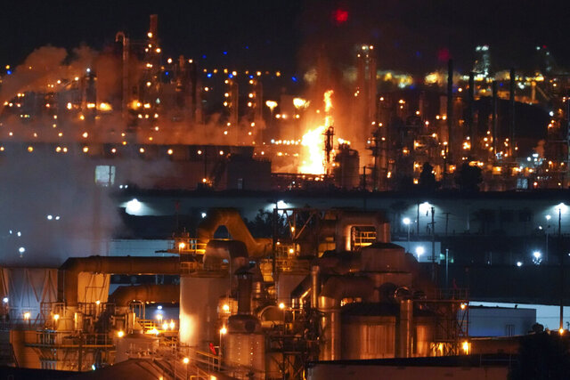 A fire burns after an explosion at the Marathon Refinery in Carson on Tuesday, Feb. 25, 2020. (Scott Varley/The Orange County Register via AP)