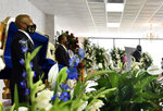 People pay their respects during a memorial service for George Floyd, Saturday, June 6, 2020, in Raeford, N.C. Floyd died after being restrained by Minneapolis police officers on May 25.  (Ed Clemente/The Fayetteville Observer via AP, Pool)