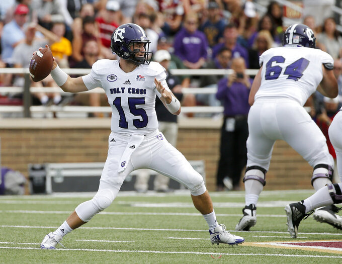 Holy Cross quarterback Geoff Wade (15) drops back to pass during the first half of an NCAA college football game against Boston College, Saturday, Sept. 8, 2018, in Boston. (AP Photo/Mary Schwalm)