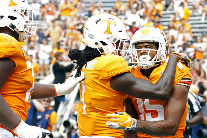FILE - In this Sept. 15, 2018, file photo, Tennessee wide receiver Jauan Jennings (15) is congratulated by wide receiver Marquez Callaway (1) after scoring a touchdown in the second half of an NCAA college football game against UTEP,  in Knoxville, Tenn. Tennessee's wide receivers savor the opportunity to play for their new position coach because they appreciate what Tee Martin accomplished during his own playing career. Martin was the starting quarterback on Tennessee's 1998 national championship team and is back at his alma mater trying to help the Volunteers become competitive again in the Southeastern Conference. (AP Photo/Wade Payne, File)