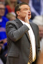 Kansas head coach Bill Self calls a play during the first half of an NCAA college basketball game against Iowa State in Lawrence, Kan., Monday, Feb. 17, 2020. (AP Photo/Orlin Wagner)