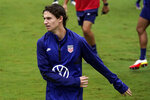 Brenden Aaronson of the U.S. Men's National Team warms up during soccer practice Tuesday, Aug. 31, 2021, in Nashville, Tenn. (AP Photo/Mark Humphrey)